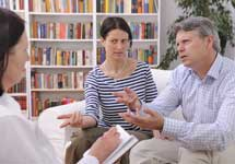 Couple Speaking With A Therapist